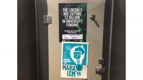 """The Liberals are cutting $2 billion in university funding"" - text on poster"